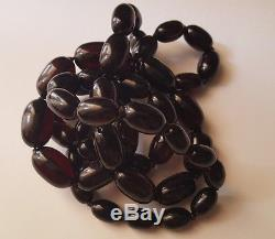 ON SALE! ANTIQUE CHERRY AMBER BAKELITE FATURAN BEADS 107 grams & 38